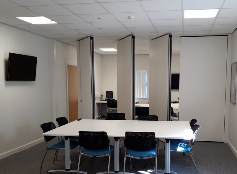 Office with movable wall partition